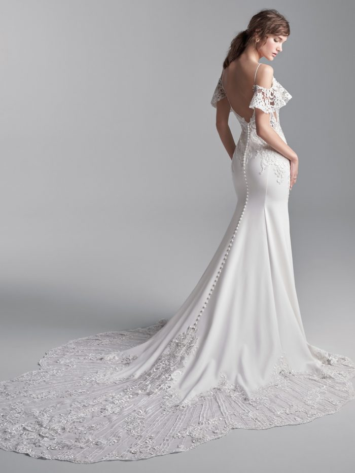 Model Wearing Cold Shoulder Sleeve Sheath Wedding Dress Called Bracken Made by Sottero and Midgley