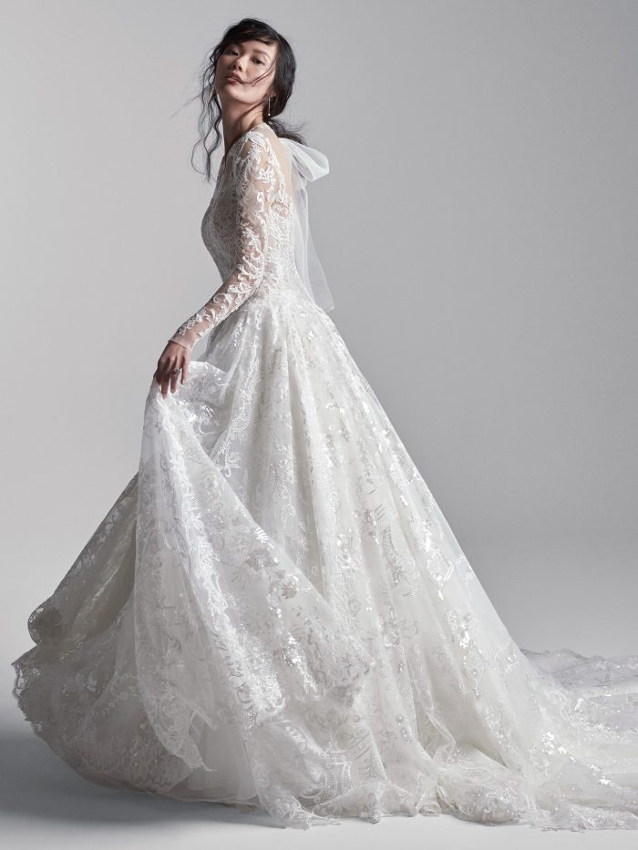 Model Wearing Long Train Princess Wedding Dress Called Xavier by Sottero and Midgley