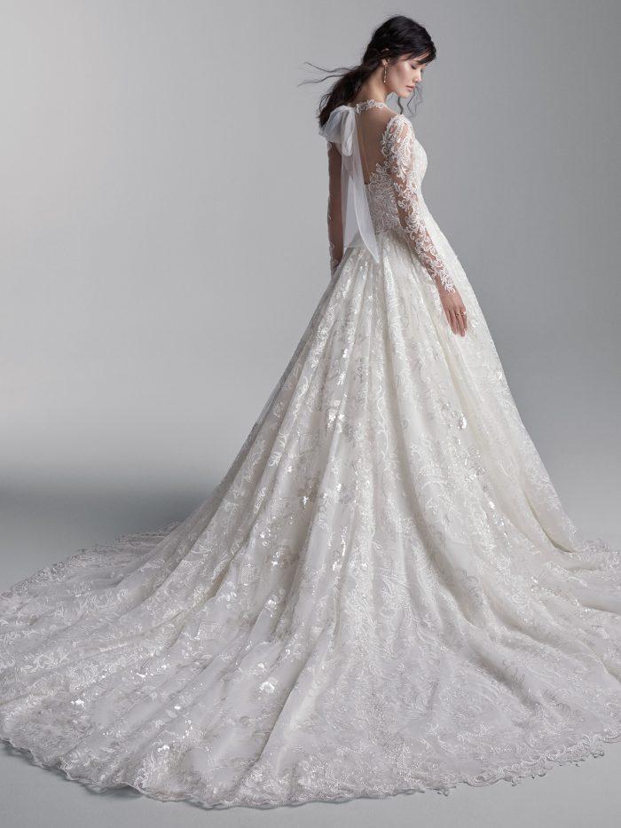Model Wearing Long Train Princess Wedding Dress Called Xavier by Sottero and Midgley