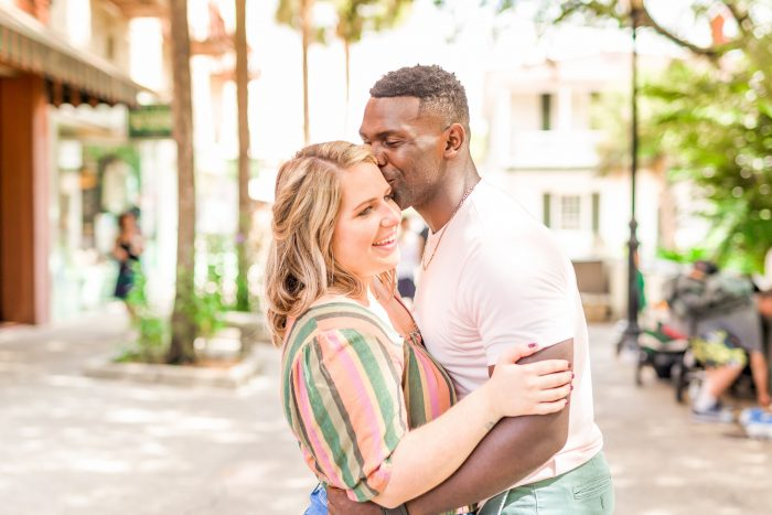 Real Curvy Bride Hugging African American Groom During Engagement Photo Shoot