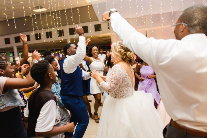 African American Groom with Real Bride Dancing at Wedding Reception in Florida