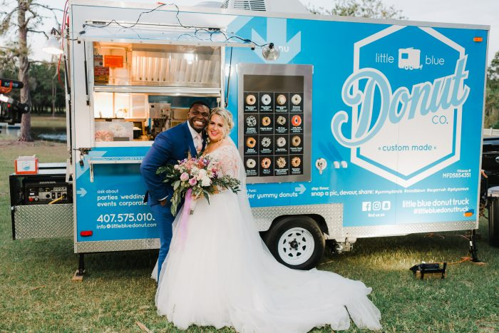 Bride and Groom in Front of Unique Donut Truck at Real Wedding