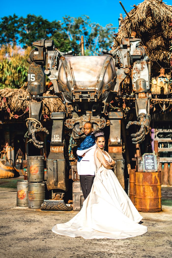 Groom Posing with Real Bride Wearing Princess Wedding Dress in Front of Star Wars Ride in Disney World