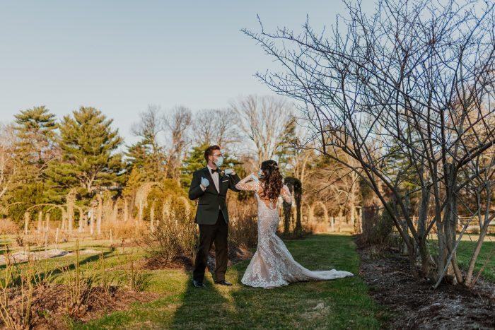 Bride and Groom Social Distancing and Wearing Masks During Coronavirus Wedding