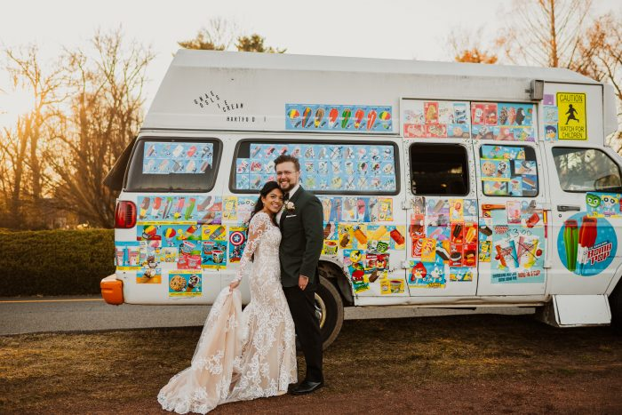 Groom with Real Bride Wearing Maggie Sottero Wedding Dress in Front of Ice Cream Truck at Woodsy Wedding