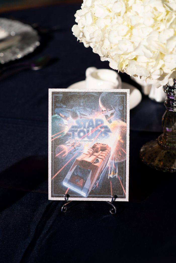 Disney Themed Table with Star Tours Ride Fast Pass at Disney World Wedding Reception at the Grand Floridian