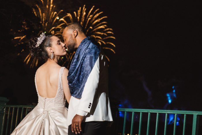Groom with Real Bride Wearing Princess Wedding Dress Watching Fireworks at Disney World the Magic Kingdom