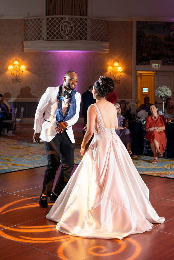 Groom Dancing with Real Bride Wearing Satin Ball Gown Wedding Dress Mylene by Maggie Sottero