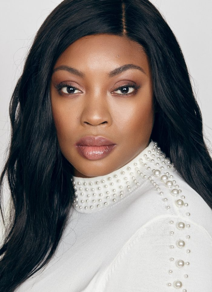 Black Plus Size Model Head Shot in White Sweater