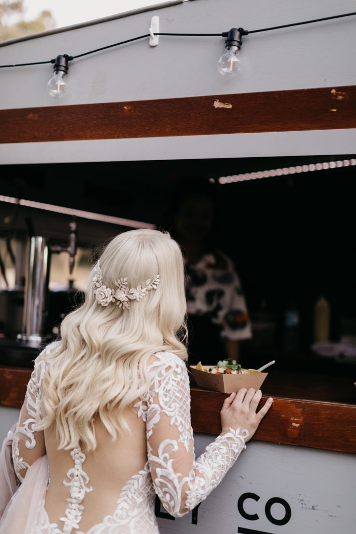 Real Bride Standing at Taco Food Truck at Festival Wedding