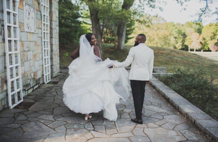 Black Bride and Groom Leaving Wedding for Honeymoon
