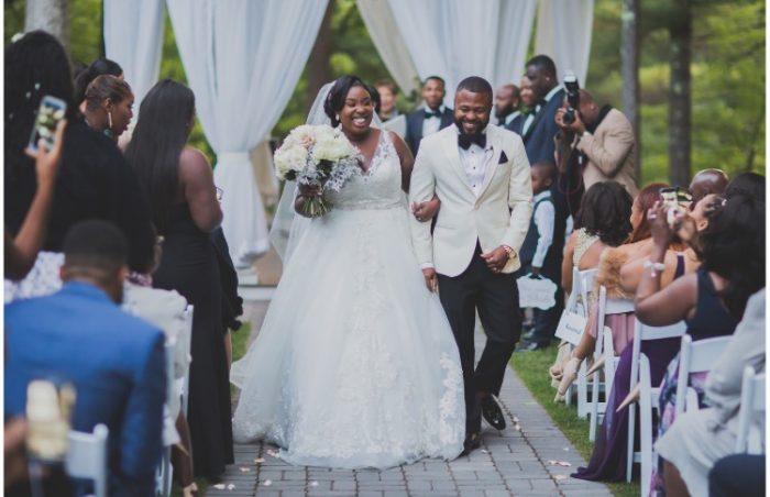 Black Bride and Groom Walking Down the Aisle During Backyard Wedding
