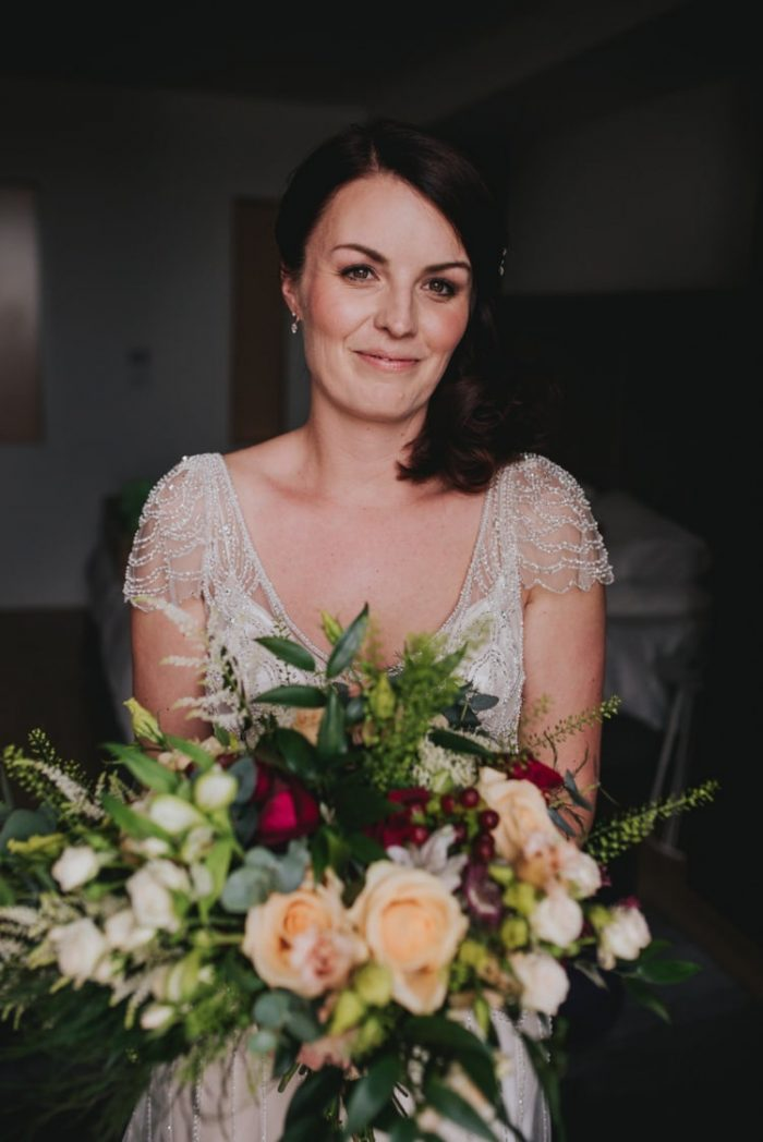 Real Bride Holding Bouquet and Wearing Festival Wedding Dress Called Ettia by Maggie Sottero