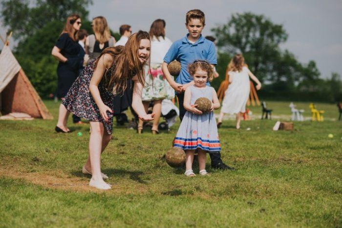 Wedding Guests Playing Yard Games at Festival Wedding