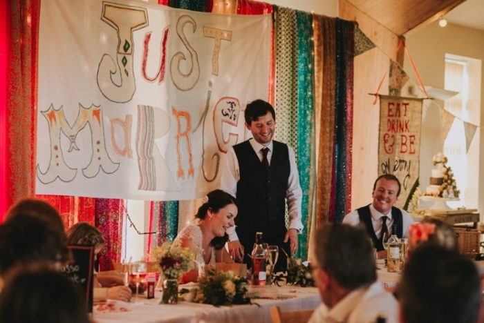 Groom with Real Bride at Festival Wedding Reception with Colorful Decor