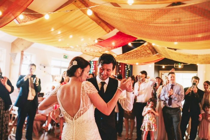 Groom Dancing with Real Bride Wearing Vintage Wedding Dress at Festival Wedding