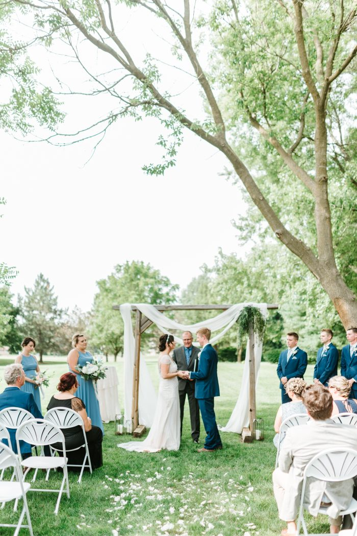Groom Kissing Real Bride During Social Distancing Wedding Ceremony Outside