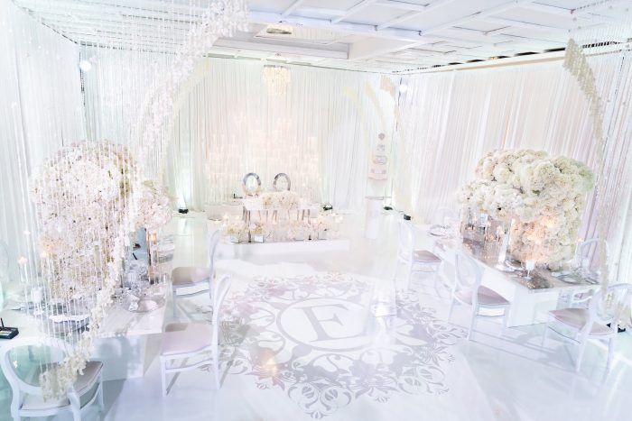 Luxurious Wedding Reception with White and Crystal Details Designed by Black Wedding Vendors