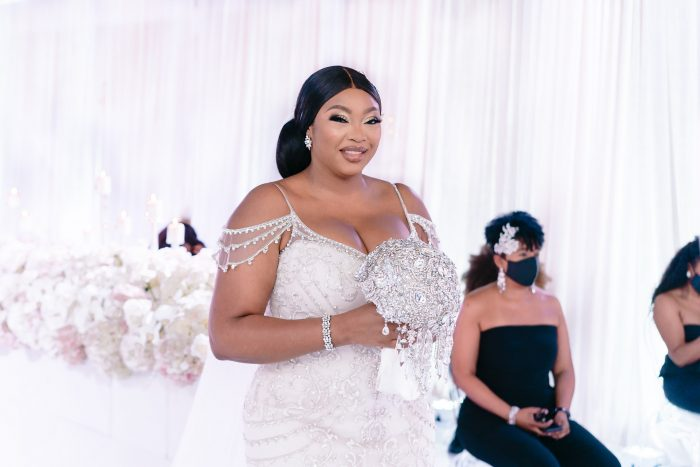 Black Bride Walking Down the Aisle and Wearing a Plus Size Maggie Sottero Wedding Dress