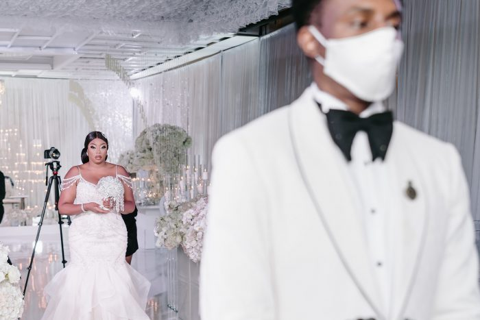 Real Bride Walking Down the Aisle at Socially Distanced Wedding While Groom Wears a Mask