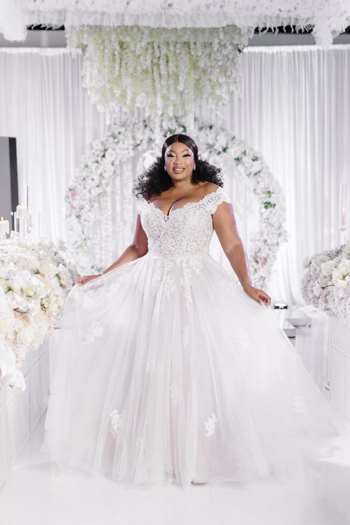 Curvy Bride Wearing Plus Size Princess Wedding Dress Called Natalie by Maggie Sottero