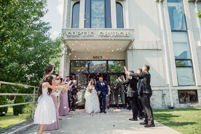 Bride and Groom Walking Out of Church at Egyptian Multicultural Wedding