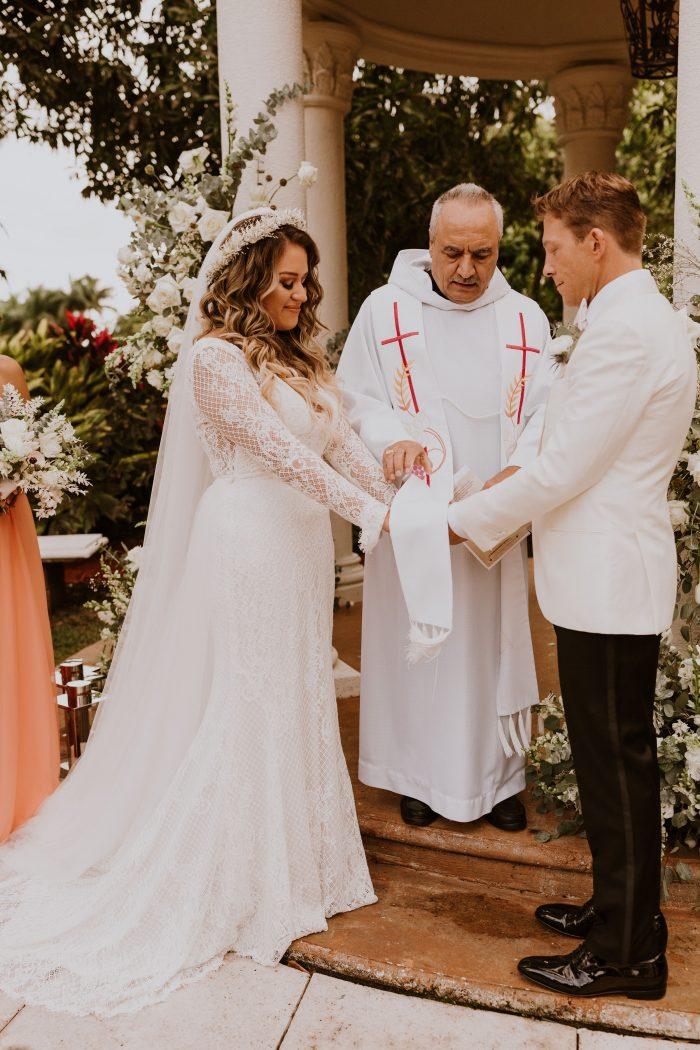 Catholic Priest Blessing Bride and Groom During Catholic Wedding Ceremony