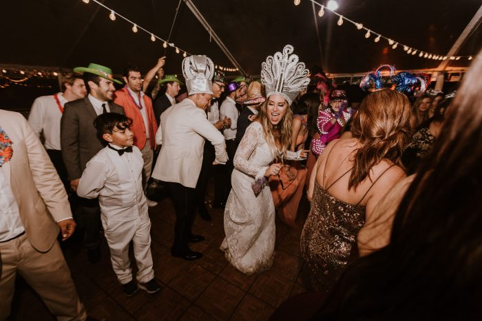 Latin Bride and Groom Dancing Together with Guests at Hora Loca at Multicultural Wedding