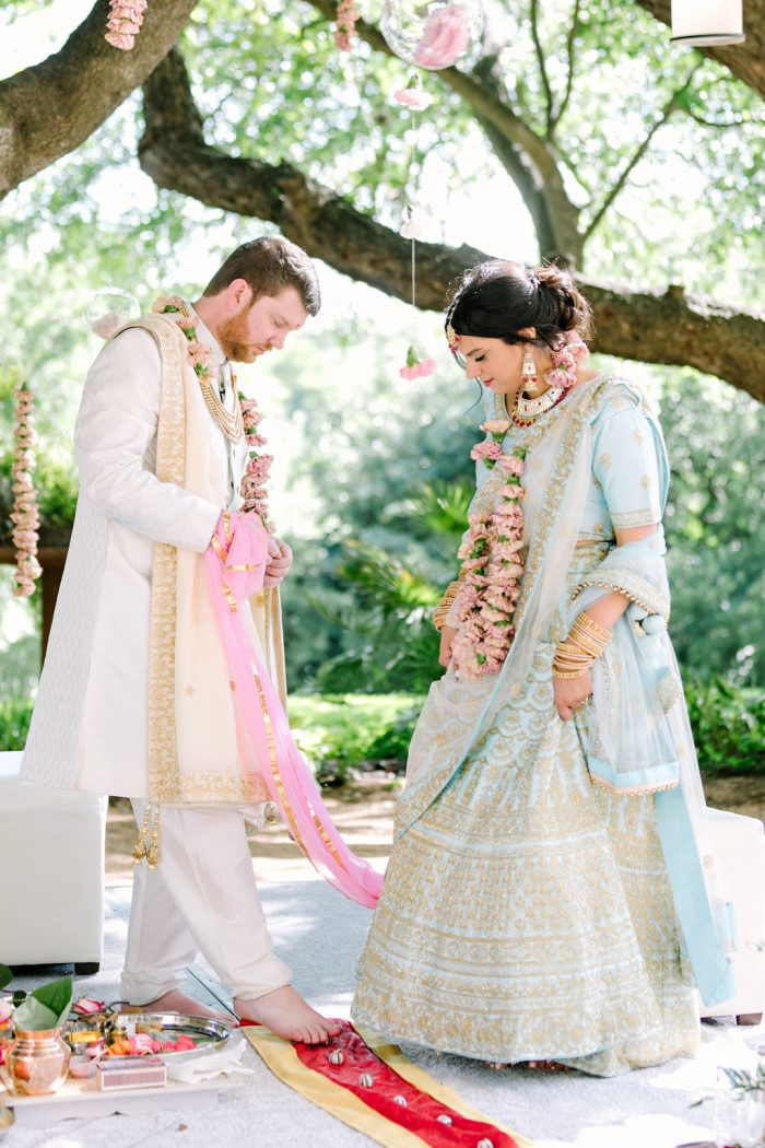 Groom with Indian Bride at Traditional Hindu Ceremony