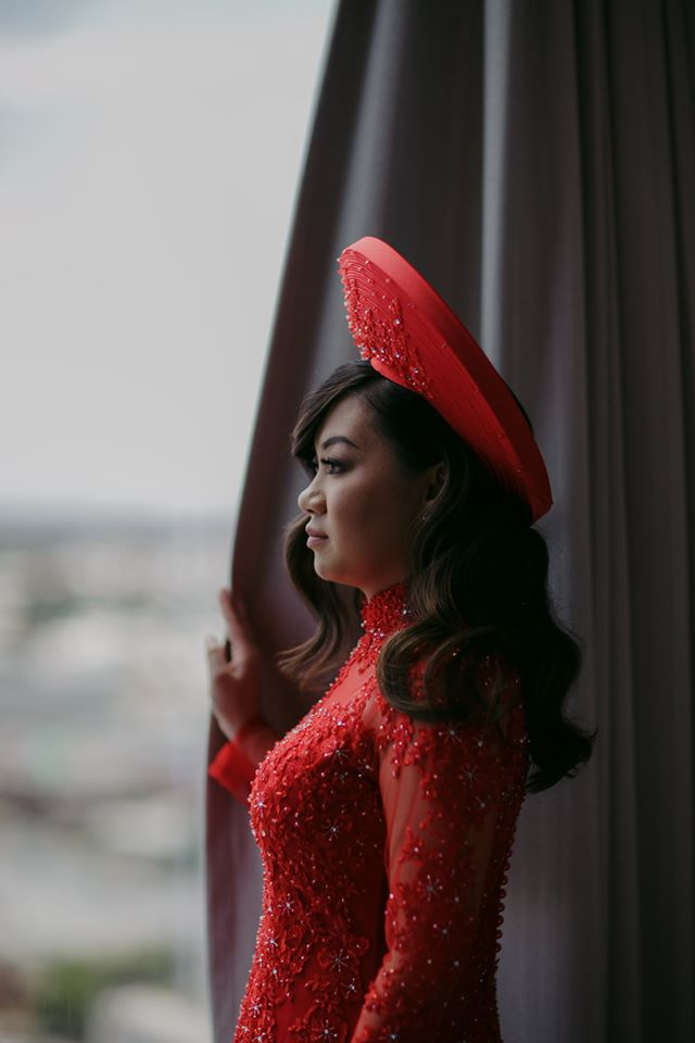 Bride Wearing Red Wedding Dress and Hat for Traditional Chinese Wedding