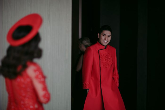 Chinese Bride and Groom Wearing Traditional Red Clothing for Chinese Wedding