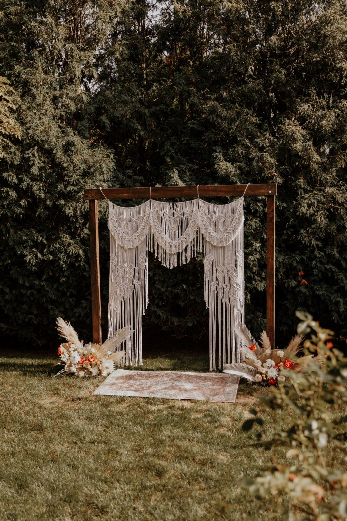 Wooden Arbor with a Woven Tapestry for Backyard Elopement