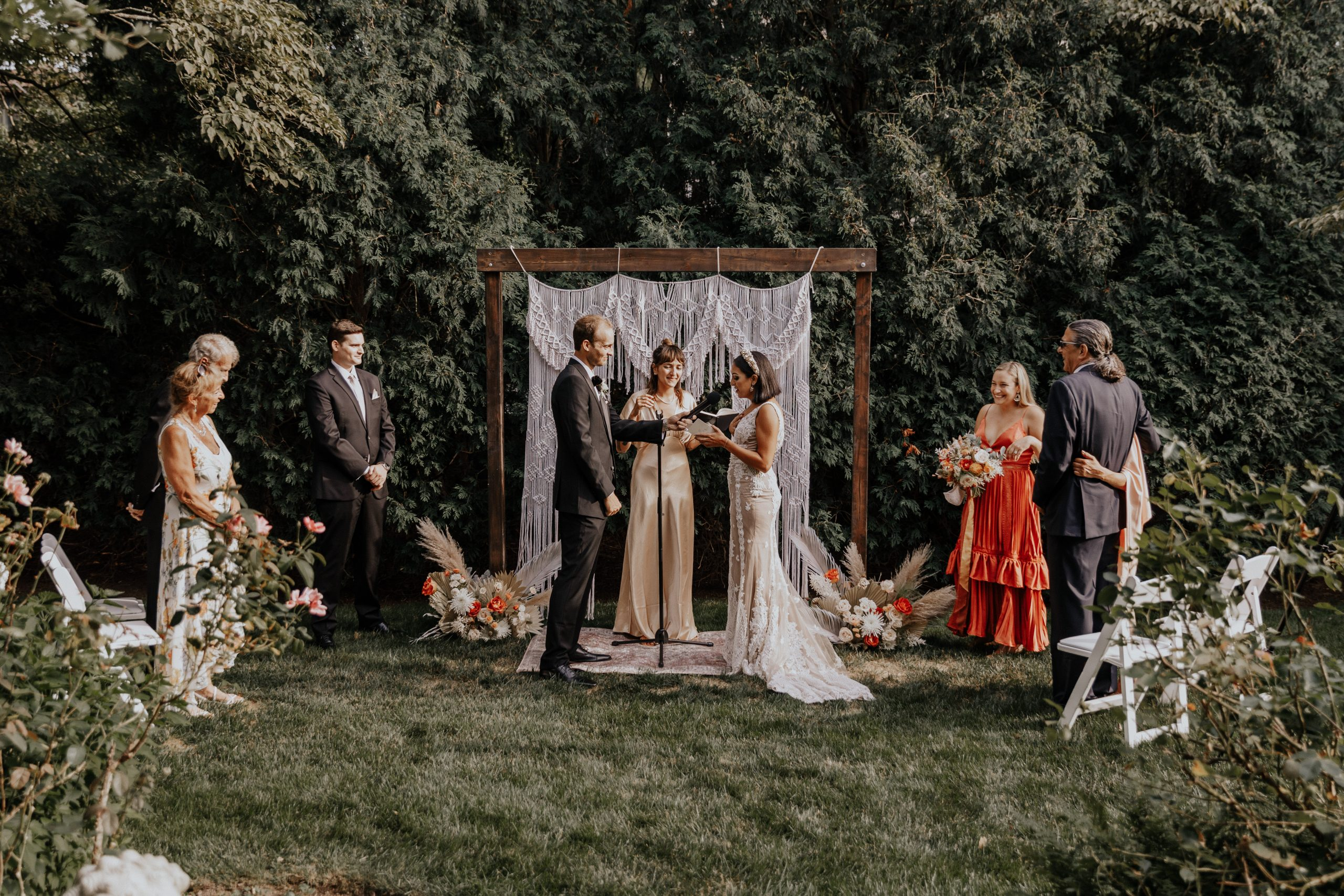 Groom with Real Bride During Backyard Elopement Ceremony with Immediate Family