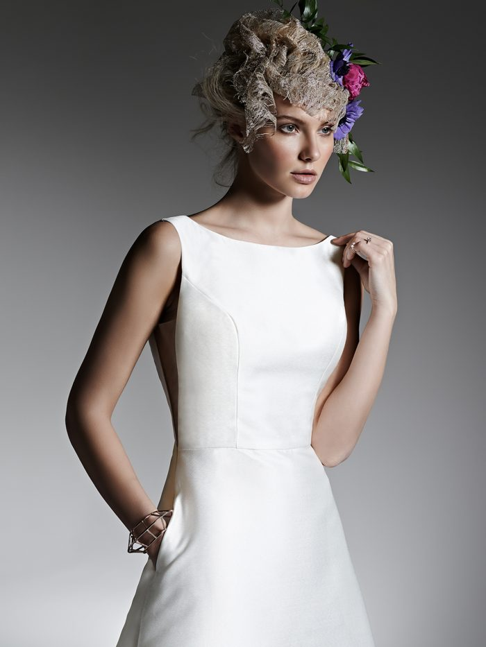 Model Wearing Simple Satin Short Wedding Dress Called McCall Lane by Sottero and Midgley