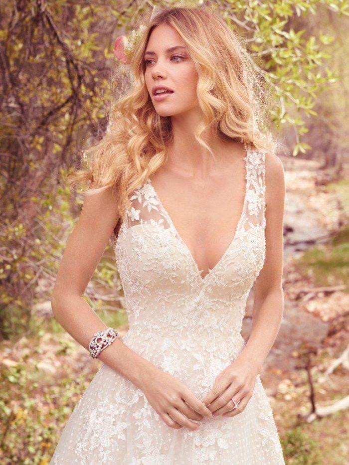 Model Wearing V-neck Polka Dot Tea Length Bridal Gown Called Meryl Lane by Maggie Sottero
