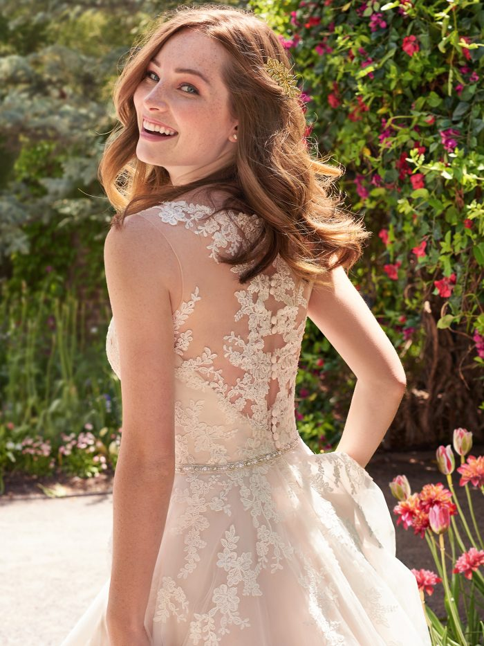 Model Wearing Key Hole Back Short Tea Length Bridal Gown Called Olivia Lane by Maggie Sottero
