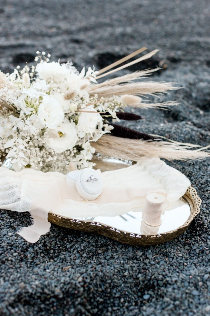 White Wedding Bouquet and Ring on Black Sand Beach