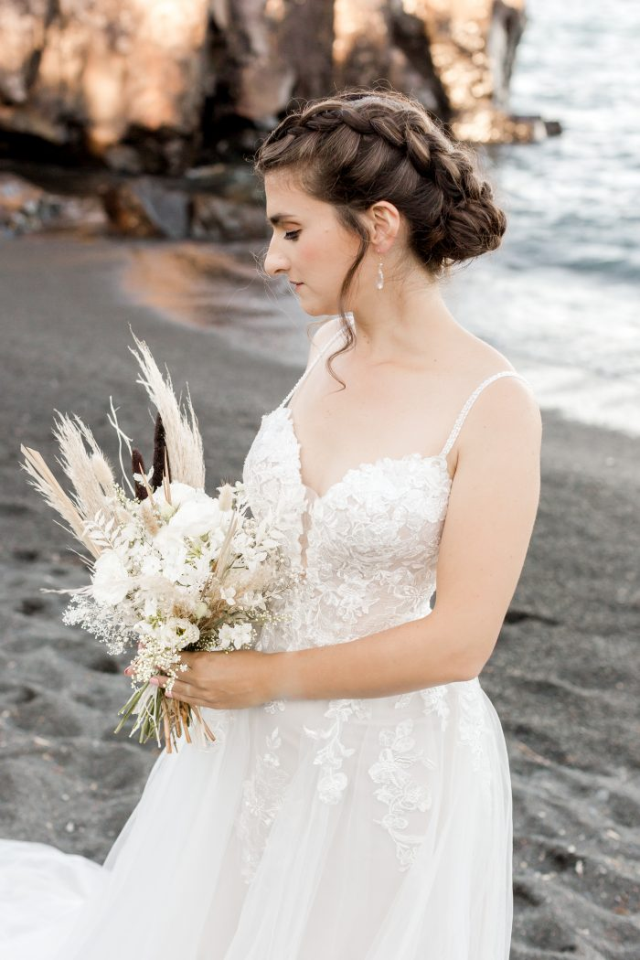 Real Bride on Beach Wearing Boho Beach Wedding Dress and Holding White Bouquet