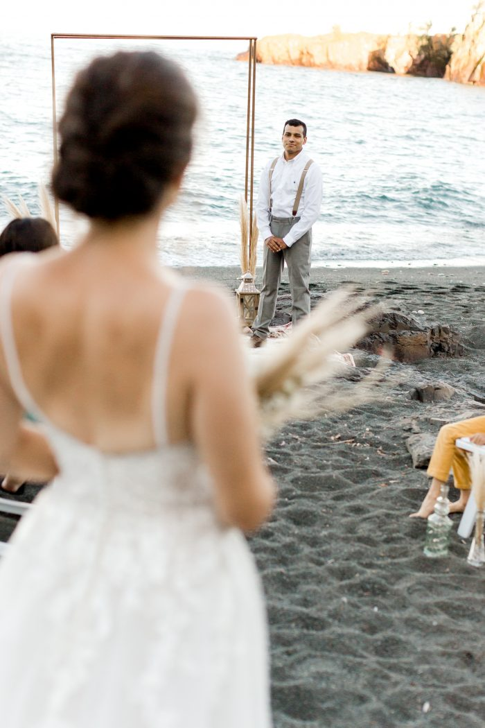 Real Bride Walking Down the Aisle in Boho Beach Wedding Dress by Maggie Sottero Towards Groom at Alter