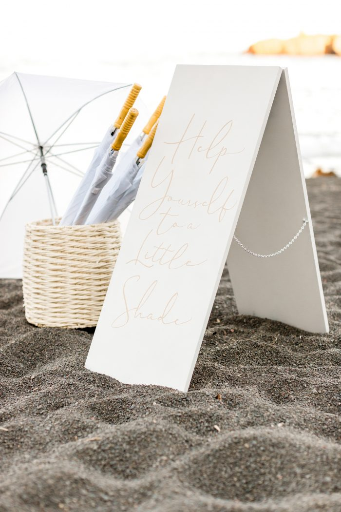 Sign with Umbrellas for Guests at Beach Elopement