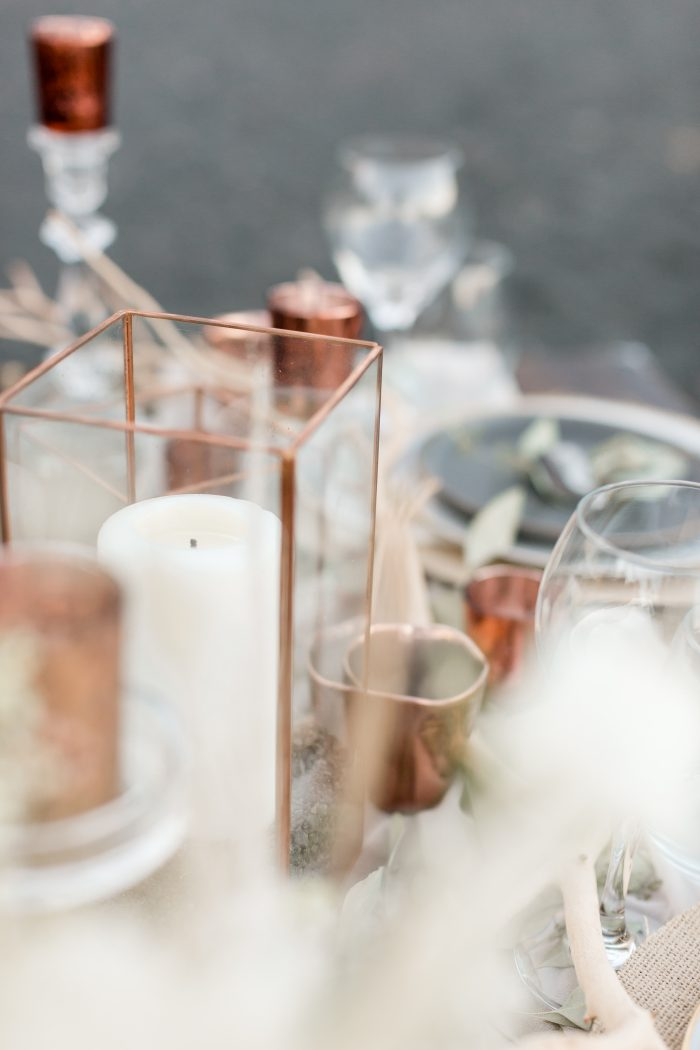 Candles and Glass Ware Featured as Wedding Details at Beach Elopement