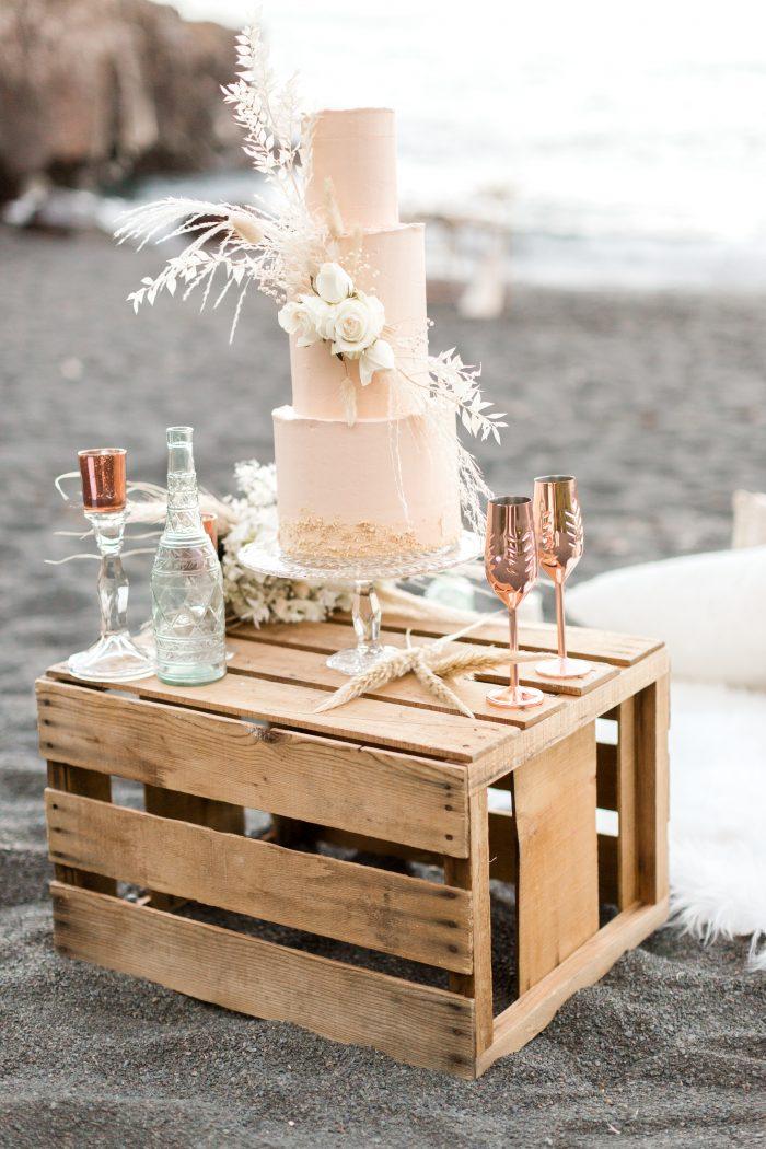 Three Tiered Wedding Cake on Driftwood Bin on Black Sand Beach