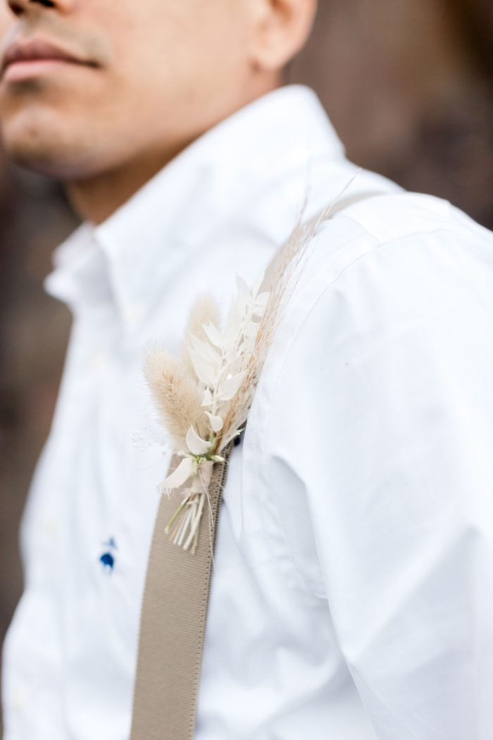 Groom Wearing Floral Boutonniere for Casual Groom's Wedding Attire