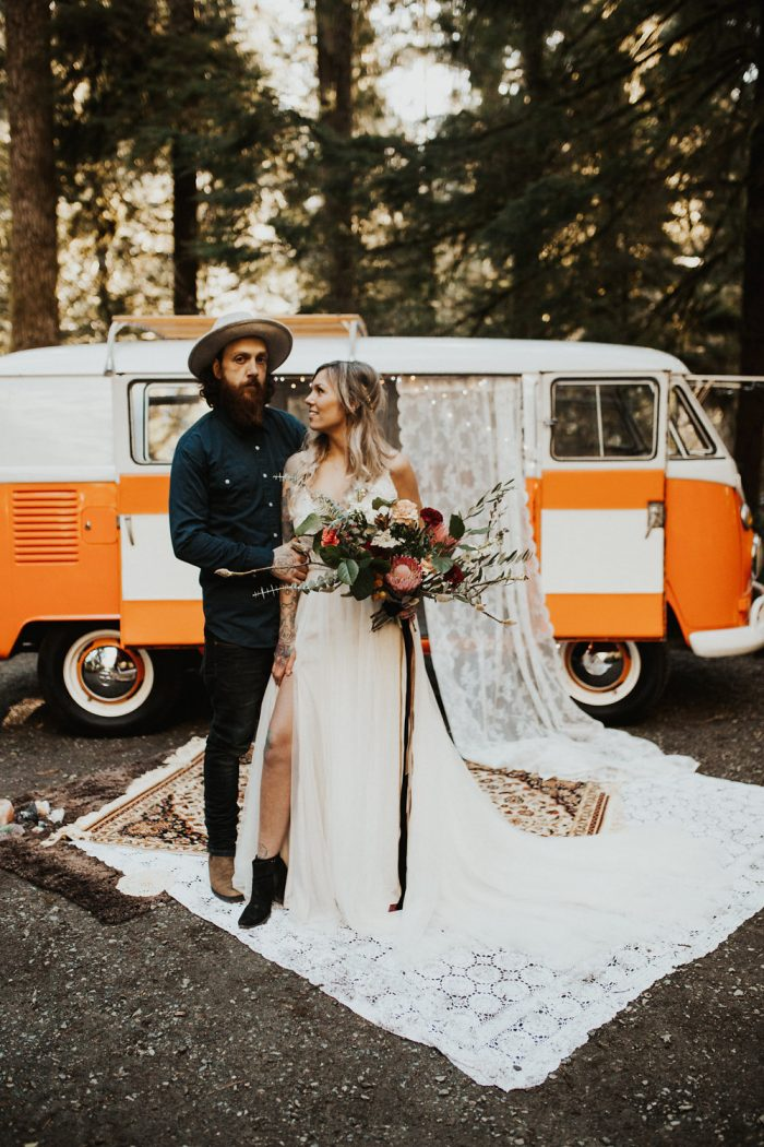 Groom in Front of Hippie Van with Bride Wearing Boho Bridal Gown Called Charlene by Maggie Sottero
