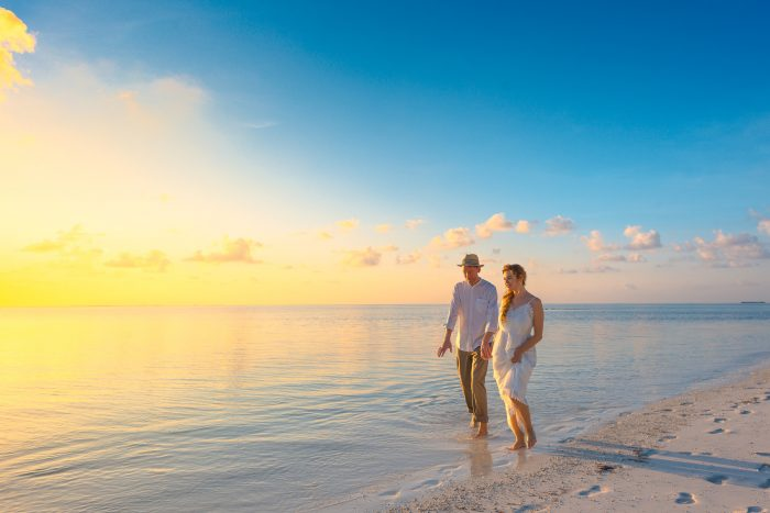 Newlywed Couple Walking on the Beach in the Maldives for Their Honeymoon