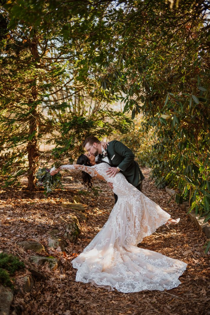 Groom Dipping and Kissing Bride Wearing Illusion Lace Sheath Wedding Gown Called Dakota by Sottero and Midgley