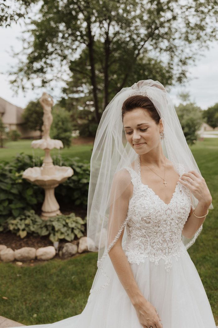Real Bride Wearing Maggie Sottero Ball Gown Wedding Dress Called Taylor Lynette with Elbow Length Wedding Veil