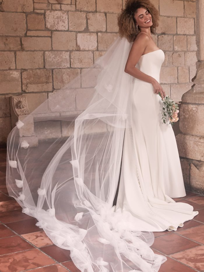 Bride Wearing Minimalist Sheath Wedding Dress with Long Tulle Wedding Veil Called Bayler by Maggie Sottero