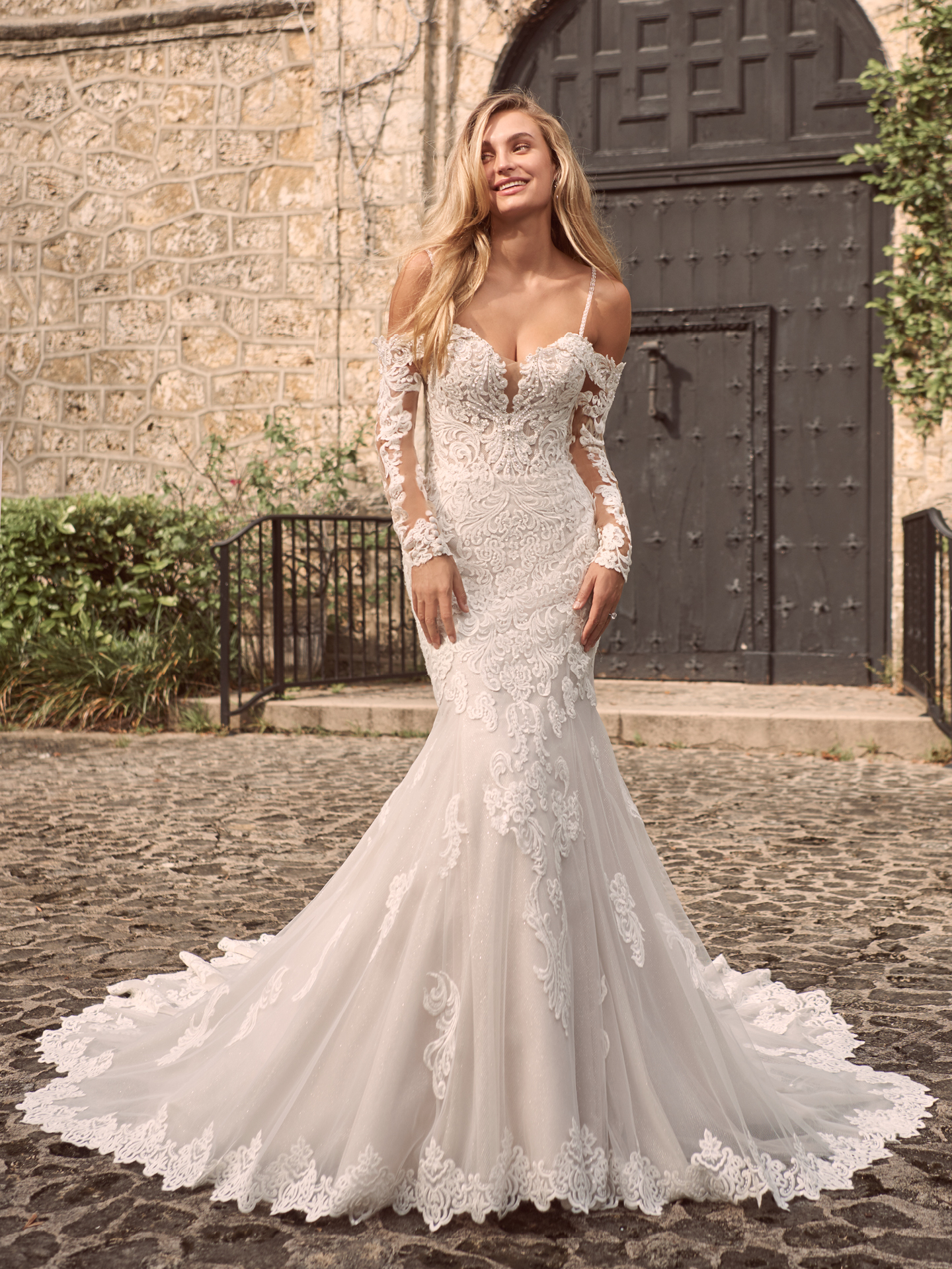 Model Wearing Off-the-Shoulder Long Sleeve Wedding Dress Called Fiona by Maggie Sottero
