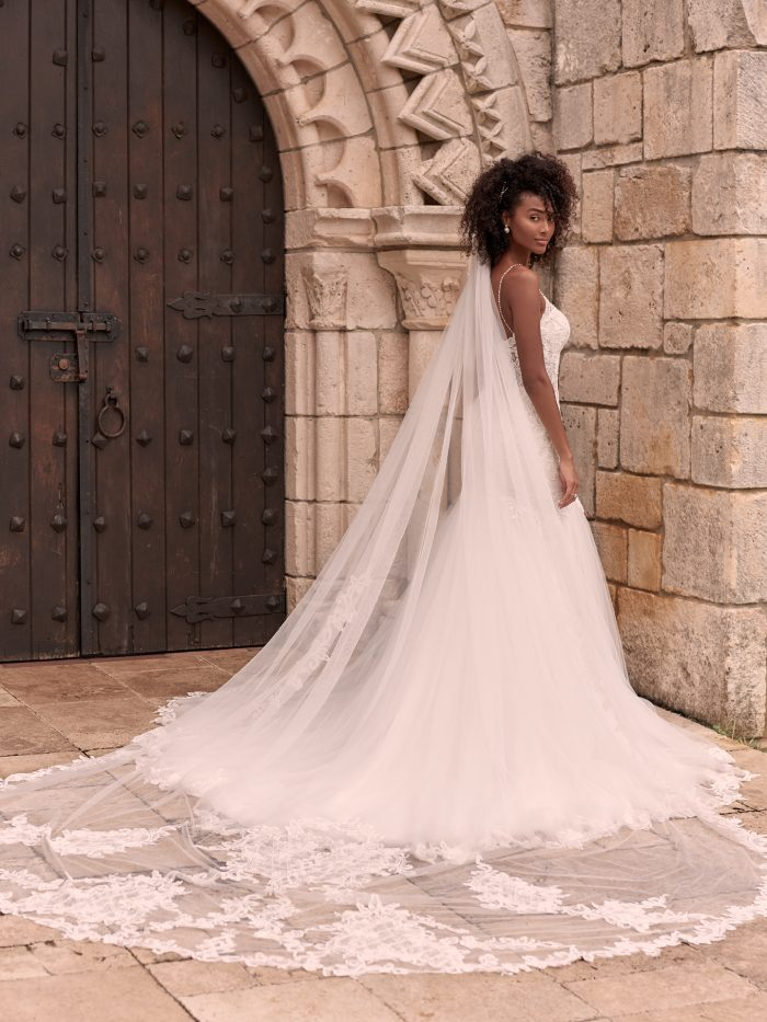 Model Wearing Lace Wedding Dress with Cathedral Length Wedding Veil Called Halle by Maggie Sottero